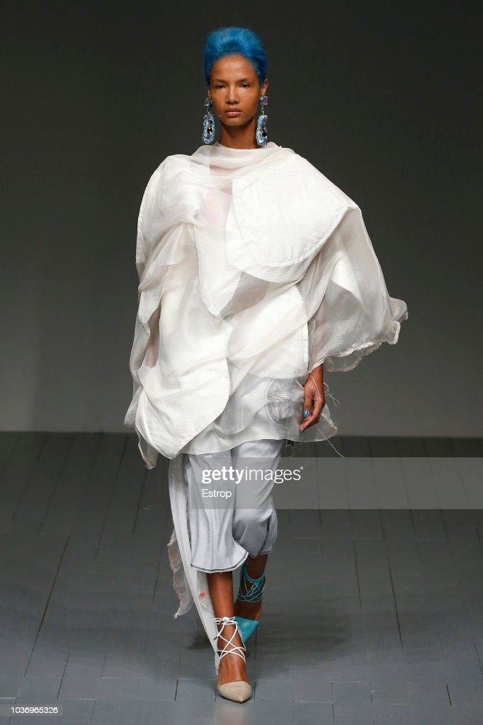 A model walks the runway at the Matty Bovan Show during London Fashion Week September 2018 at The BFC Show Space on September 14, 2018 in London, England.