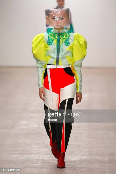 A model walks the runway at the Matty Bovan show during London Fashion Week September 2019 at the BFC Show Space on September 13 2019 in London...
