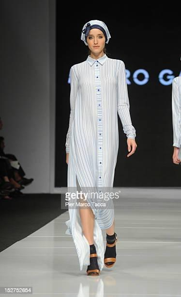 Model walks the runway at the Mauro Gasperi New Upcoming Designers Spring/Summer 2013 fashion show as part of Milan Womenswear Fashion Week on...