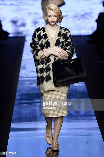 Model walks the runway at the Max Mara Autumn Winter 2015 fashion show during Milan Fashion Week on February 26, 2015 in Milan, Italy.