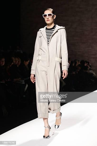 Model walks the runway at the Max Mara Autumn/Winter 2012/2013 fashion show as part of Milan Womenswear Fashion Week on February 23, 2012 in Milan,...