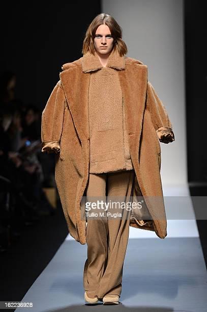 Model walks the runway at the Max Mara fashion show during Milan Fashion Week Womenswear Fall/Winter 2013/14 on February 21, 2013 in Milan, Italy.