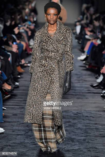 A model walks the runway at the Max Mara Ready to Wear Fall/Winter 20182019 fashion show during Milan Fashion Week Fall/Winter 2018/19 on February 22...