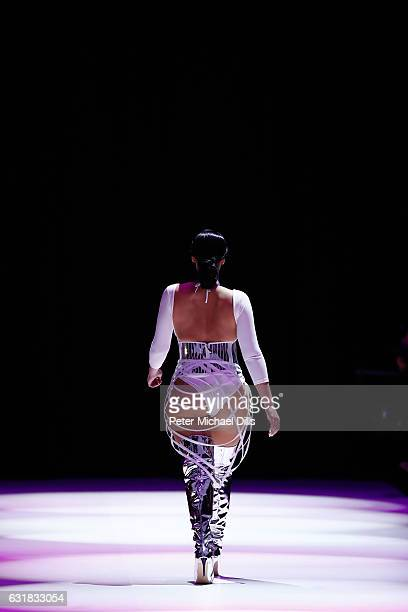 A model walks the runway at the Maybelline Hot Trendsxhibition 2017 show during the MercedesBenz Fashion Week Berlin A/W 2017 at Motorwerk on January...