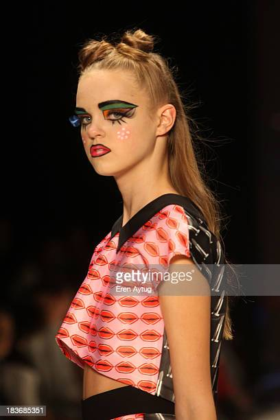A model walks the runway at the Maybelline New York By DB Berdan show during MercedesBenz Fashion Week Istanbul s/s 2014 presented by American...