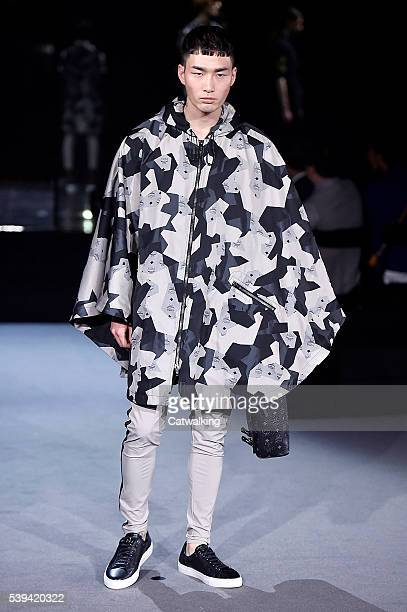 A model walks the runway at the MCM x Christopher Raeburn Spring Summer 2017 fashion show during London Menswear Fashion Week on June 11 2016 in...
