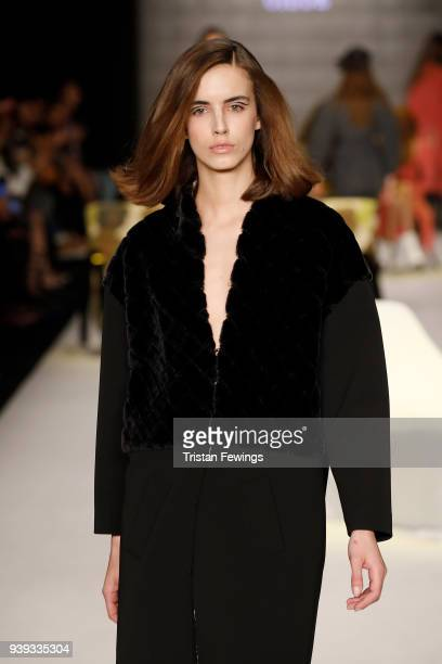 A model walks the runway at the Mehtap Elaidi show during Mercedes Benz Fashion Week Istanbul at Zorlu Performance Hall on March 28 2018 in Istanbul...