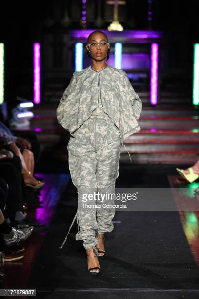 A model walks the runway at the Melange Movement show during New York Fashion Week 2019 at Saint Mary's Episcopal Church in Harlem on September 06...