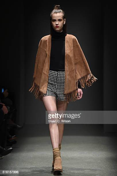 A model walks the runway at the Meltem Oezbek show during the MercedesBenz Fashion Week Istanbul Autumn/Winter 2016 at Zorlu Center on March 17 2016...