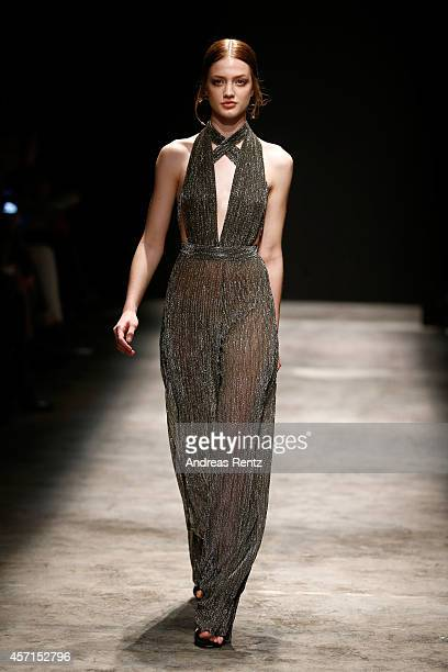 A model walks the runway at the Meltem Ozbek show during Mercedes Benz Fashion Week Istanbul SS15 at Antrepo 3 on October 13 2014 in Istanbul Turkey
