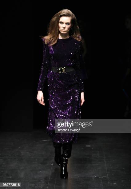 A model walks the runway at the Meltem Ozbek show during Mercedes Benz Fashion Week Istanbul at Zorlu Performance Hall on March 29 2018 in Istanbul...