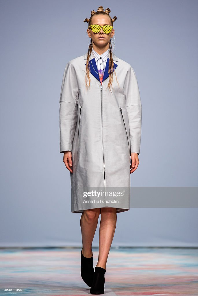 A model walks the runway at the Menckel show at Fashion Week in Stockholm SS 15 on August 28, 2014 in Stockholm, Sweden.