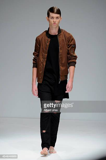 A model walks the runway at the Menswear Collective fashion show during MercedesBenz Fashion Week Spring 2015 at Helen Mills Event Space on September...