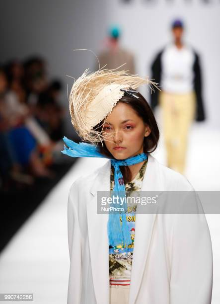 A model walks the runway at the MercedesBenz Presents Botter show during the Berlin Fashion Week Spring/Summer 2019 at ewerk on July 3 2018 in Berlin...