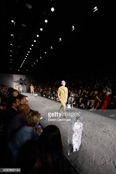 A model walks the runway at the MercedesBenz presents Brand Who show during the MercedesBenz Istanbul Fashion Week at Zorlu Performance Hall on...