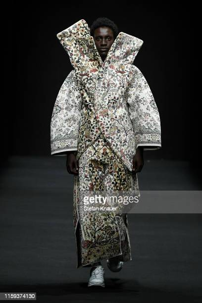 A model walks the runway at the MercedesBenz presents Christoph Rumpf show during the Berlin Fashion Week Spring/Summer 2020 at ewerk on July 01 2019...