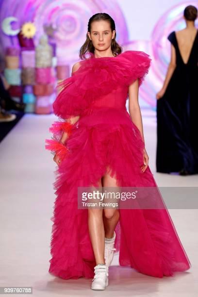 A model walks the runway at the MercedesBenz presents Sudi Etuz show during Mercedes Benz Fashion Week Istanbul at Zorlu Performance Hall on March 29...