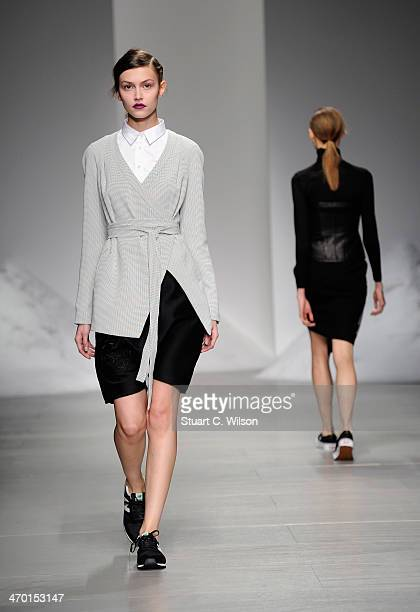 A model walks the runway at the MercedesBenz Simon Gao A/W 2014 Show at Somerset House on February 18 2014 in London England