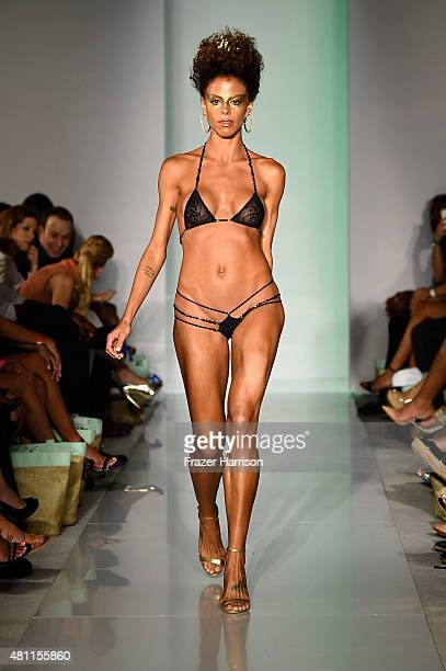 A model walks the runway at the Mia Marcelle Swimwear 2016 Collection during SWIMMIAMI at 1 Hotel South Beach Salon on July 17 2015 in Miami Beach...