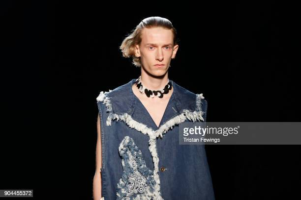 A model walks the runway at the Miaoran show during Milan Men's Fashion Week Fall/Winter 2018/19 on January 13 2018 in Milan Italy