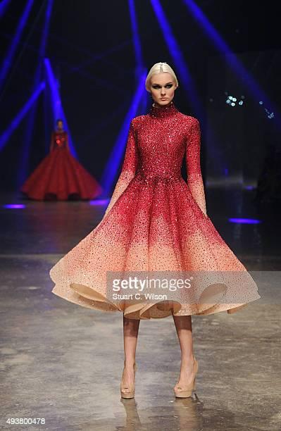 A model walks the runway at the Michael Cinco show during Dubai Fashion Forward Spring/Summer 2016 at Madinat Jumeirah on October 22 2015 in Dubai...