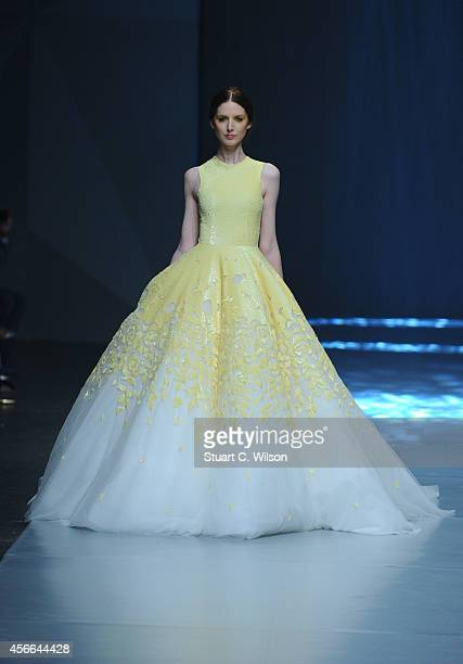 A model walks the runway at the Michael Cinco show during Fashion Forward at Madinat Jumeirah on October 4 2014 in Dubai United Arab Emirates
