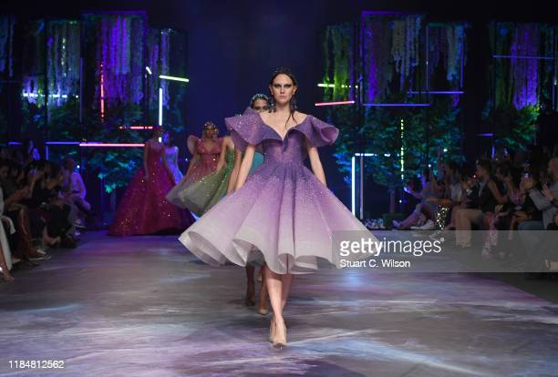 A model walks the runway at the Michael Cinco show during the FFWD October Edition 2019 at the Dubai Design District on October 31 2019 in Dubai...