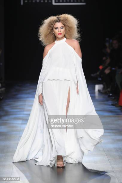 A model walks the runway at the Michael Costello show during New York Fashion Week The Shows at Gallery 1 Skylight Clarkson Sq on February 9 2017 in...