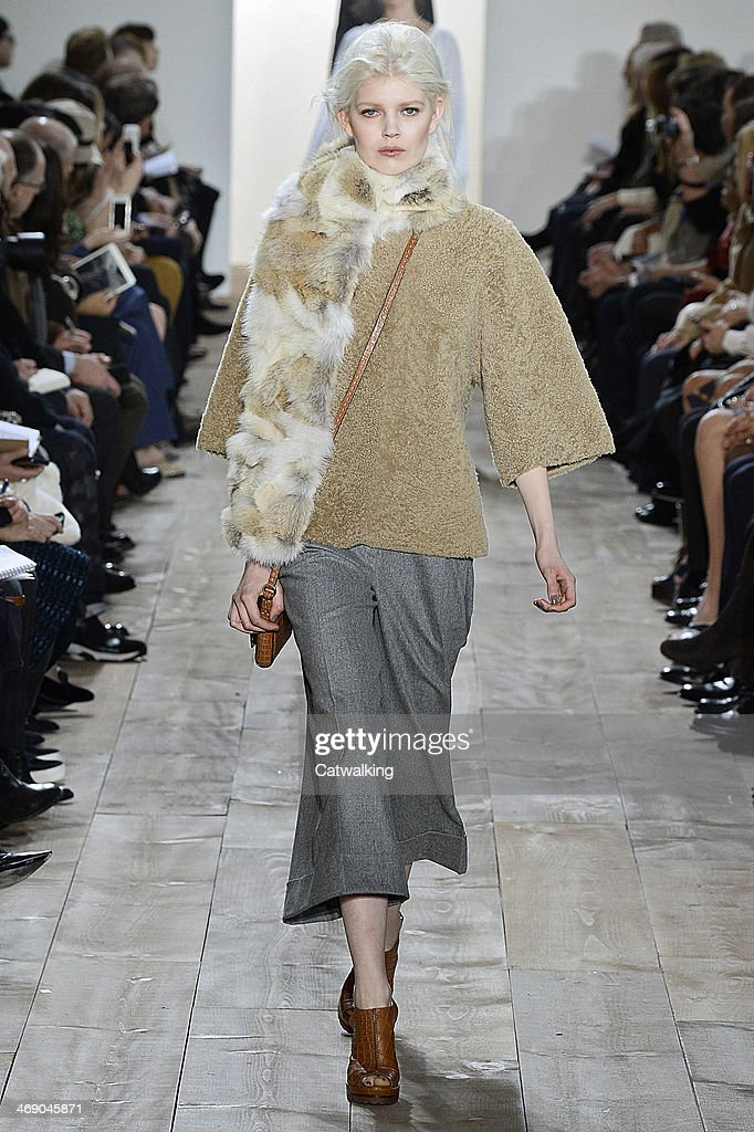 A model walks the runway at the Michael Kors Autumn Winter 2014 fashion show during New York Fashion Week on February 12, 2014 in New York, United States.