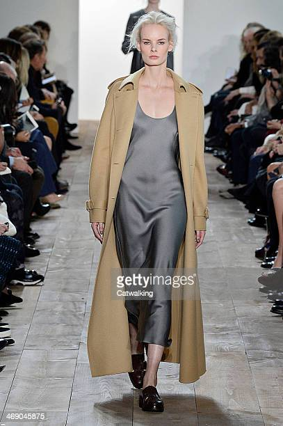 Model walks the runway at the Michael Kors Autumn Winter 2014 fashion show during New York Fashion Week on February 12, 2014 in New York, United...