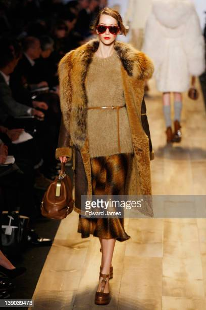 Model walks the runway at the Michael Kors Fall 2012 fashion show during Mercedes-Benz Fashion Week at The Theatre at Lincoln Center on February 15,...