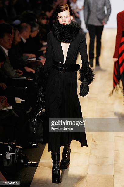 A model walks the runway at the Michael Kors Fall 2012 fashion show during MercedesBenz Fashion Week at The Theatre at Lincoln Center on February 15...