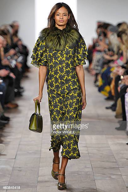 A model walks the runway at the Michael Kors fashion show during MercedesBenz Fashion Week Fall on February 18 2015 in New York City