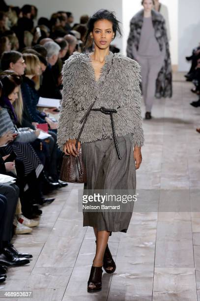 A model walks the runway at the Michael Kors fashion show during MercedesBenz Fashion Week Fall 2014 at Spring Studios on February 12 2014 in New...