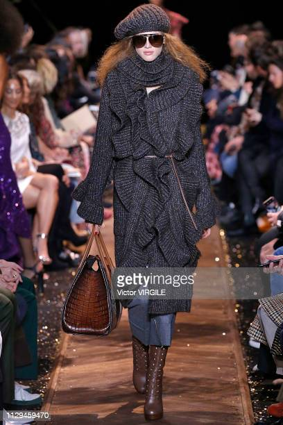 Model walks the runway at the Michael Kors Ready to Wear Fall/Winter 2019-2020 fashion show during New York Fashion Week on February 13, 2019 in New...