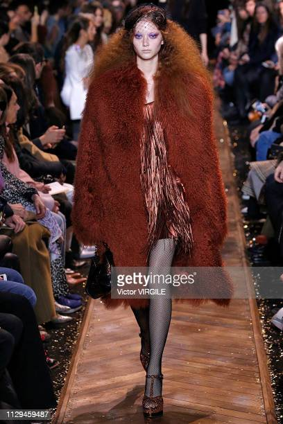 A model walks the runway at the Michael Kors Ready to Wear Fall/Winter 20192020 fashion show during New York Fashion Week on February 13 2019 in New...