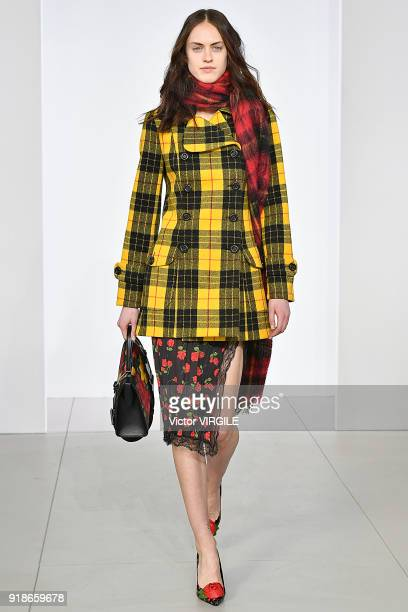 A model walks the runway at the Michael Kors Ready to Wear Fall/Winter 20182019 fashion show during New York Fashion Week on February 14 2018 in New...