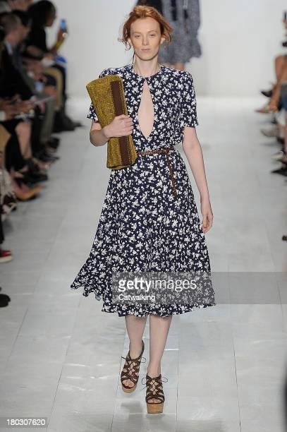 Model walks the runway at the Michael Kors Spring Summer 2014 fashion show during New York Fashion Week on September 11, 2013 in New York, United...