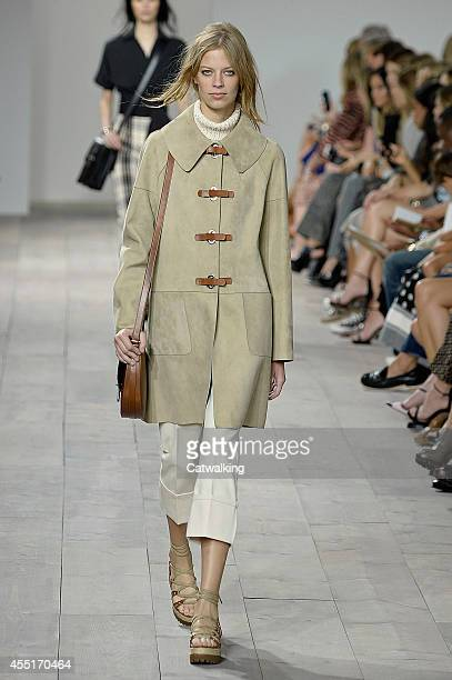 Model walks the runway at the Michael Kors Spring Summer 2015 fashion show during New York Fashion Week on September 10, 2014 in New York, United...