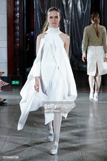 Models walk the runway at the Michael Olestad show during Oslo Runway SS19 at Bankplassen 4 on August 15 2018 in Oslo Norway