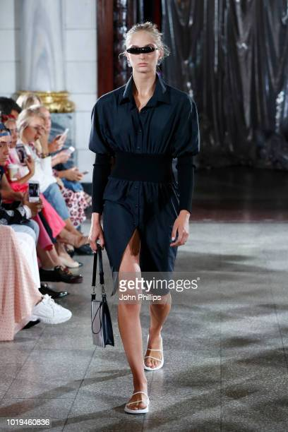 A model walks the runway at the Michael Olestad show during Oslo Runway SS19 at Bankplassen 4 on August 15 2018 in Oslo Norway