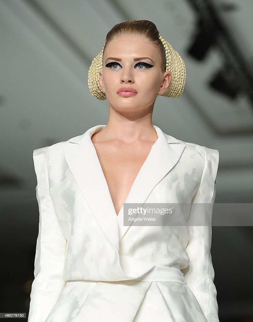 A model walks the runway at the MICHALSKY StyleNite 2015 at Ritz Carlton on July 10, 2015 in Berlin, Germany.