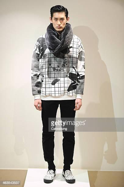 A model walks the runway at the Miharayasuhiro Autumn Winter 2014 fashion show during Paris Menswear Fashion Week on January 18 2014 in Paris France