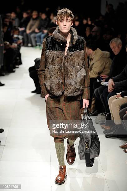 A model walks the runway at the Miharayasuhiro menswear fashion show during Paris Fashion Menswear Week on January 22 2011 in Paris France