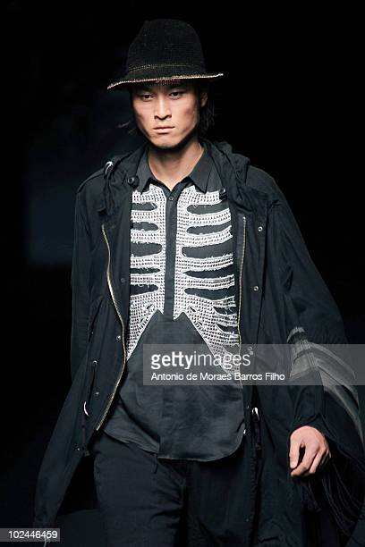 A model walks the runway at the Miharayasuhiro showas part of Paris Menswear Fashion Week Spring/Summer 2011 at Le Carrousel du Louvre on June 26...
