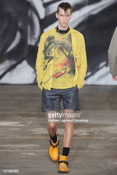A model walks the runway at the Miharayasuhiro Spring Summer 2013 fashion show during Paris Menswear Fashion Week on June 30 2012 in Paris France