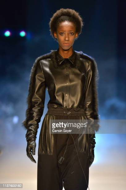 A model walks the runway at the MiiN by Kadir Kilic show during MercedesBenz Istanbul Fashion Week at Zorlu Performance Hall on March 22 2019 in...