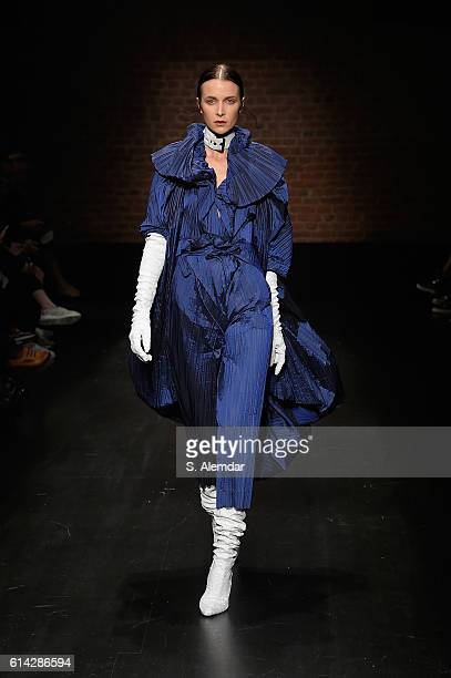 Model walks the runway at the MiiN show during Mercedes-Benz Fashion Week Istanbul at Zorlu Center on October 13, 2016 in Istanbul, Turkey.