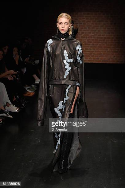 A model walks the runway at the MiiN show during MercedesBenz Fashion Week Istanbul at Zorlu Center on October 13 2016 in Istanbul Turkey