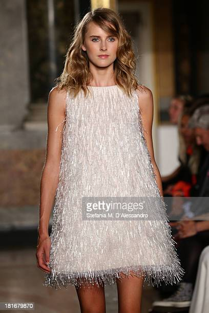 A model walks the runway at the Mila Schon show as a part of Milan Fashion Week Womenswear Spring/Summer 2014 at on September 23 2013 in Milan Italy